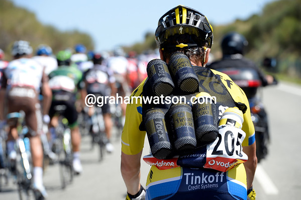 It's feeding time at the zoo sorry, the peloton, and Sergio Paulinho is the unlucky wearer of Tinkoff's water-bottle vest...