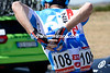 Andrew Talansky is quietly putting water-bottles into his jersey, it's a skillful job...