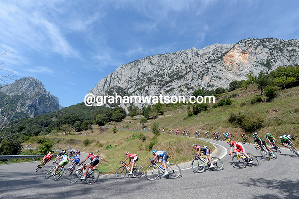 The peloton is enjoying the descent more than the ascent on such a beautiful day...