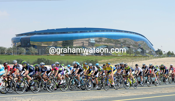 The peloton passes a fancy-looking sports stadium about 50-kilometres into the stage...
