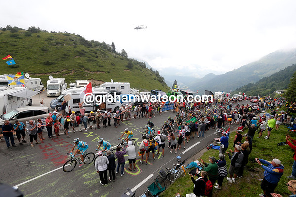 Astana leads a small peloton halfway up the Tourmalet, where the clouds are coming down on the race...
