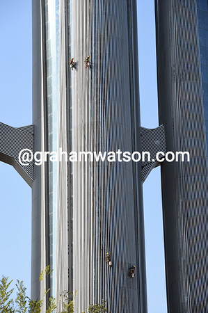 Why are these men cleaning the massive stems of the Olympic Park Observation Tower..?