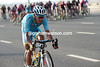 Paolo Tiralongo is trying to bridge across for Astana and Guardini...