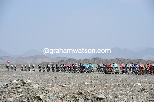 The peloton speeds towards the hills on the Oman border...