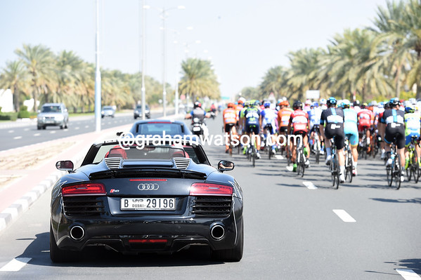 Only in Dubai - a pair of Audi R8 roadsters overtake the peloton in the neutralised section...