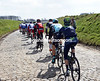 The race speeds up across the cobblestones of Mater, but the gap is about nine-minutes...