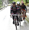 Simon Geschke leads the first escape with Domont and a Vini Fantini rider...