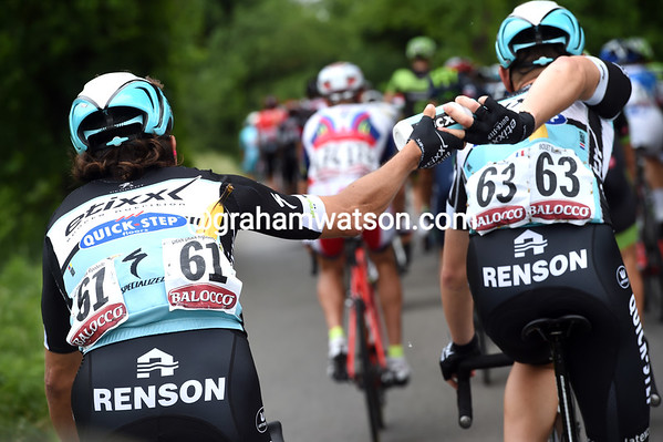 Bouet now shows his flexibility by back-handing a bottle to Uran...