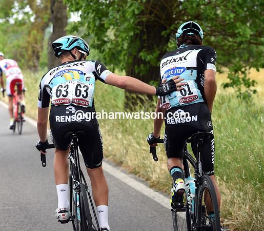Maxime Bouet is a hard-working man - here he's pushing Rigoberto Uran along...