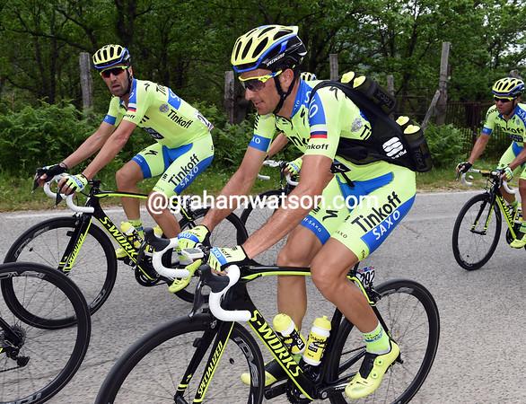 Basso has been given bottle-carrying duties - a bit of a comedown for a former Giro winner...