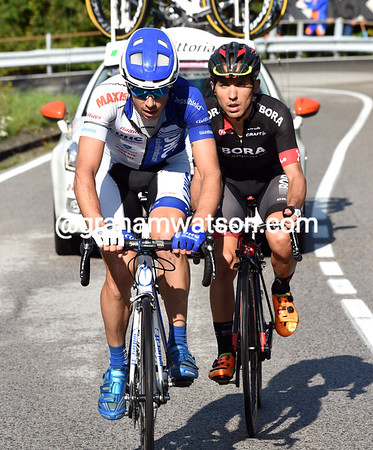 Canola and Benedetti approach the summit of the Ghisallo with a full minute over their nearest chasers...