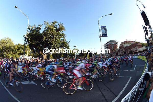 A compact peloton tackles the first bend of 26 laps of the circuit...