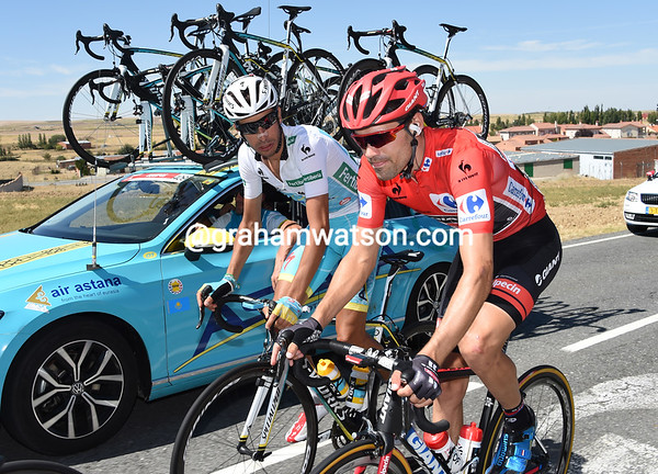 Dumoulin checks Aru is okay as they make their way back to the peloton...