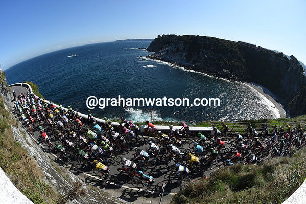 The peloton leaves the start above Luarca with views of the Atlantic Ocean to enjoy...
