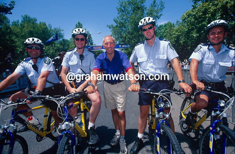 Phil Liggett with South Australian police officers at the 1999 Tour Down Under