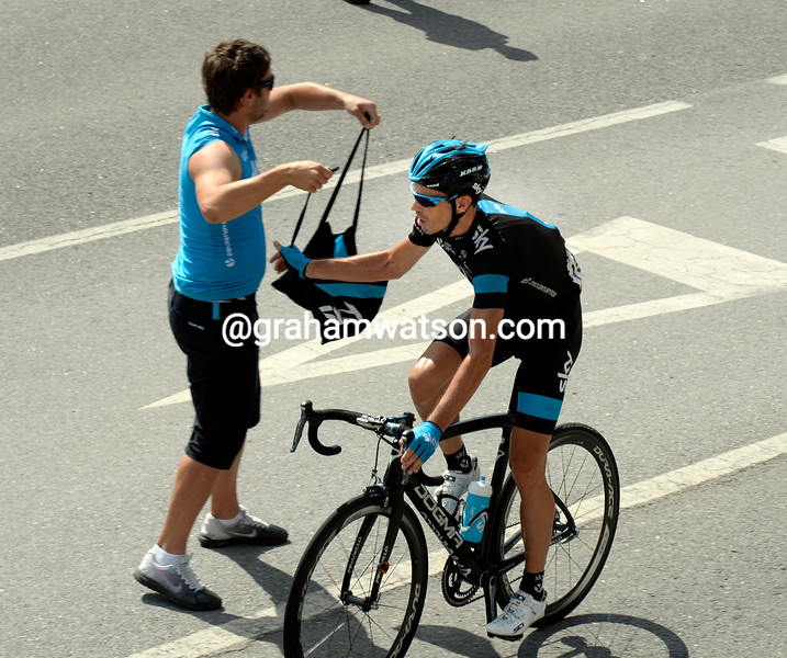 Phillip Deignan grabs his feed-bag in the 2014 Tour of Spain