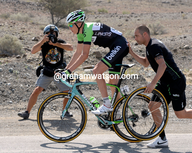 Robert Gesink makes a wheel change on stage four of the 2014 Tour of Oman