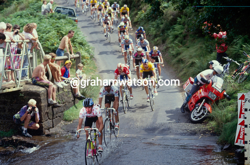 The peloton is led by Robert Millar as it crosses Westerdale Ford in the 1989 Kellogg's Tour of Britain
