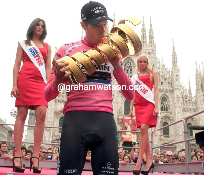 Ryder Hesjedal celebrates on the podium after winning the 2012 Giro d'Italia