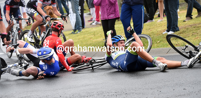 Sam Bewley crashes on a slippery bend in the 2016 Cadel Evans Great Ocean Road Race