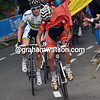 Sammy Sanchez gets tangled in a fan's flag in the mens road race championships