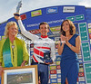 Stage_winner_Simon_Yates_on_podium.jpg