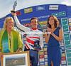 Stage_winner_Simon_Yates_on_podium.jpg
