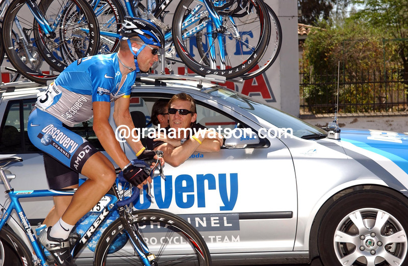 STIJN DEVOLDER CHATS WITH MANAGER AND FRIEND, DIRK DE MOL, AT HIS TEAM CAR ON STAGE THREE
