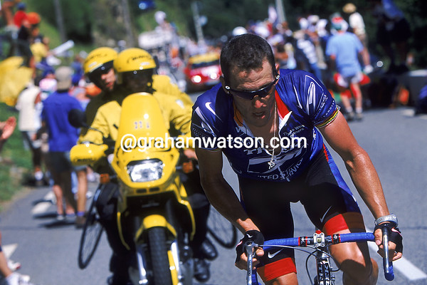 Lance Armstrong attacks to win a stage of the 2001 Tour de France at Pla d'Adet