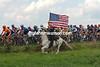 A horseman salutes the 2004 Tour de France in Belgium