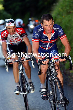 Lance Armstrong leads Ivan Basso in the 2004 Tour de France