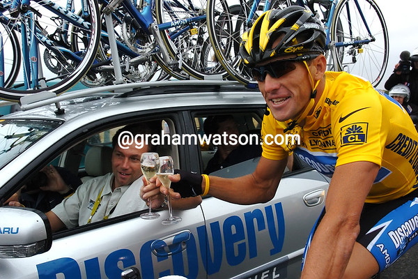 Lance Armstrong celebrate winning the 2005 Tour with Johan Bruyneel