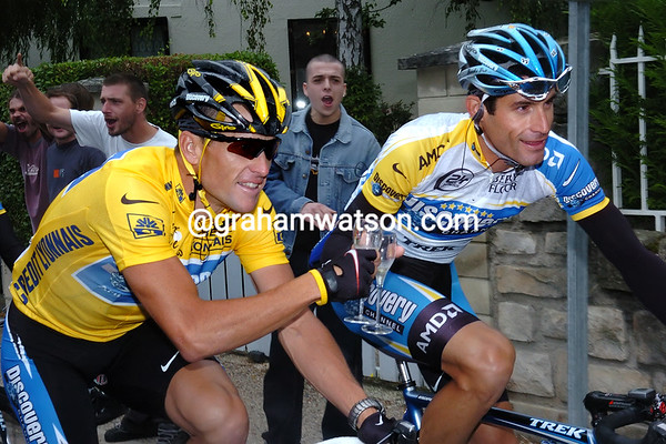 Lance Armstrong celebrates with George Hincapie near the end of the 2005 Tour de France
