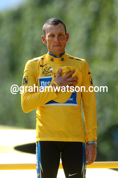 Lance Armstrong poses as winner of the 2005 Tour de France in Paris
