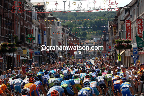 The 2006 Tour de France crosses a Belgian town on its back to France