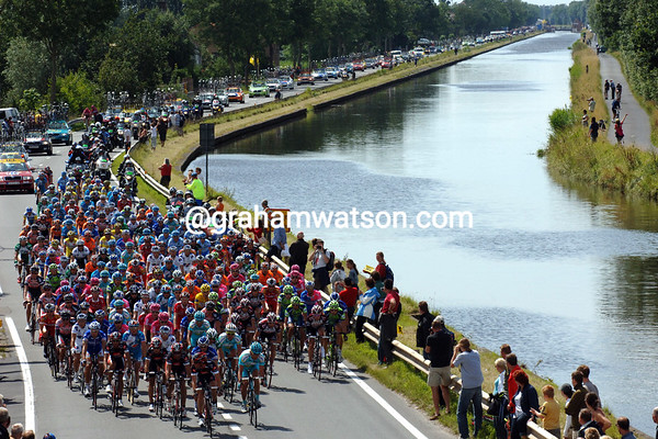 THE PELOTON BESIDE A CANAL IN BELGIUM ON STAGE TWO OF THE 2007 TOUR DE FRANCE