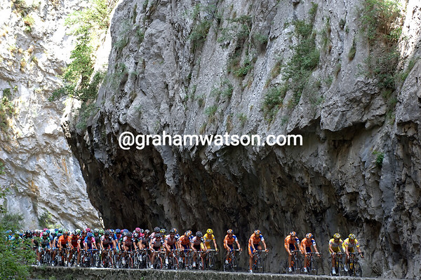 THE PELOTON PASSES THROUGH A GORGE ON STAGE FOURTEEN OF THE 2007 TOUR DE FRANCE