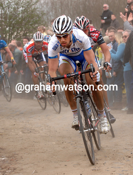 TOM BOONEN ATTACKS ACROSS THE  COBBLESTONES AT CYSOING
