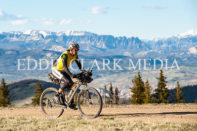 Mathew Lee climbs Union Pass with the Shoshoni Mountains in the background.