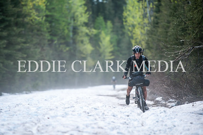 David Goldberg one-foots it through the last bits of snow on Upper Whitefish Lake Rd.