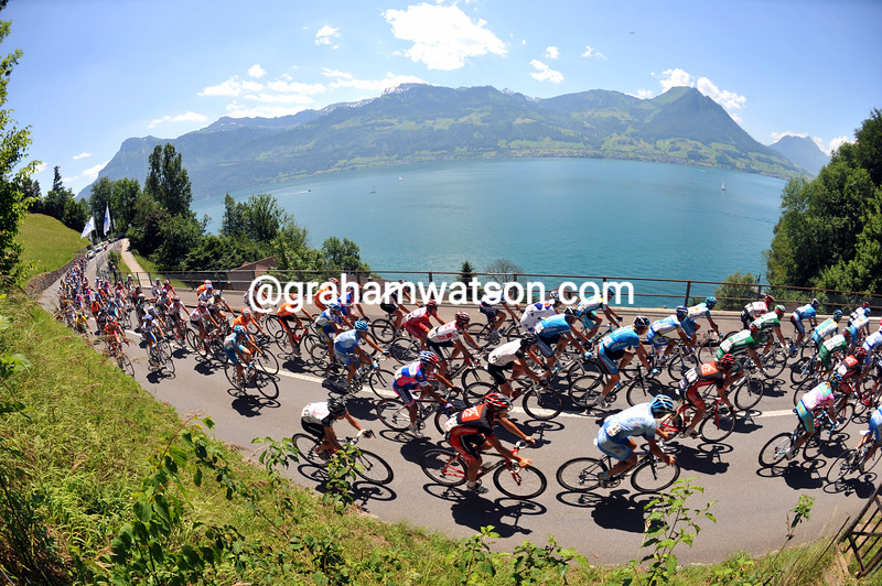 THE PELOTON SKIRTS LAKE LUCERNE ON STAGE NINE OF THE 2008 TOUR DE SUISSE