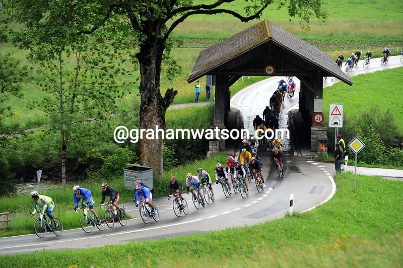 The peloton crosses a wooden bridge in the 2013 Tour de Suisse