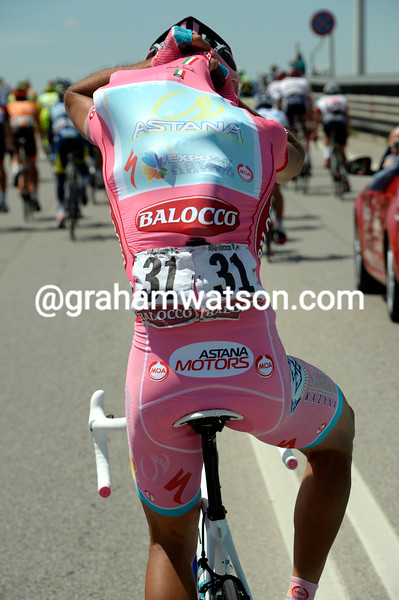 Vincenzo Nibali collects water bottles on stage twenty one at the 2013 Giro d'Italia