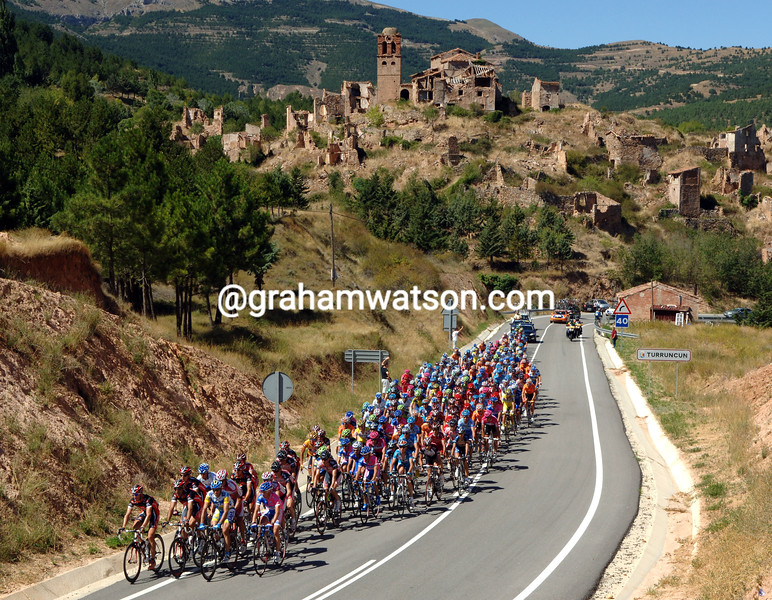 The 2012 Vuelta passes a deserted village in La Rioja region