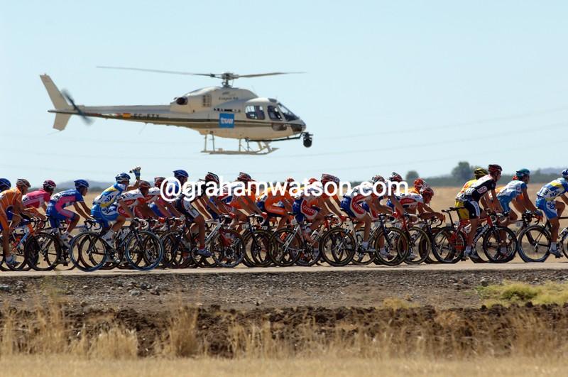 A TV helicopter flies over the peloton in the 2006 Vuelta a España