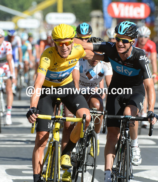 Bradley Wiggins and Michael Rogers celebrate on stage twenty of the 2012 Tour de France
