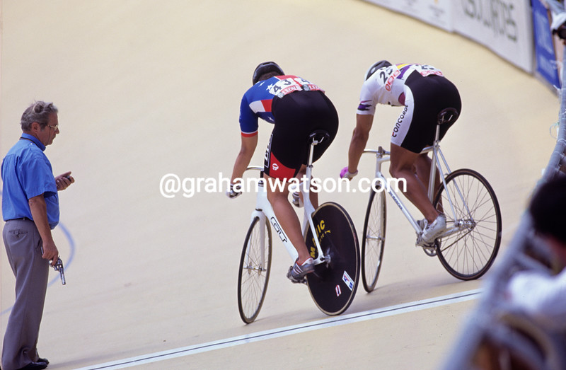 Two cyclists conduct a track stand during sprint racing at the 1995 World Championships