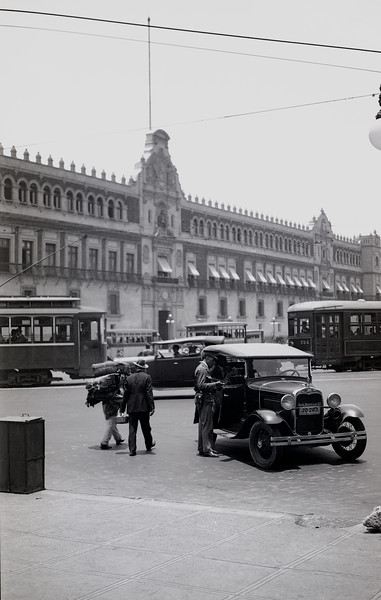 Driver in a 1930 Ford Phaeton talking to a cop in front of the Palacio Nacional, Zocalo, Mexico City, Mexico.