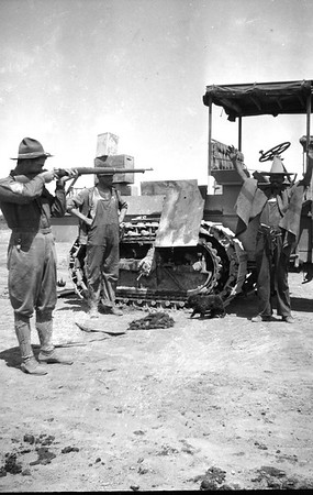 Soldiers horsing around during the 1916 Punitive Expedition. I'm pretty sure the guy next to the tractor is pretending to be Pancho Villa, who the expedition was sent to go after.