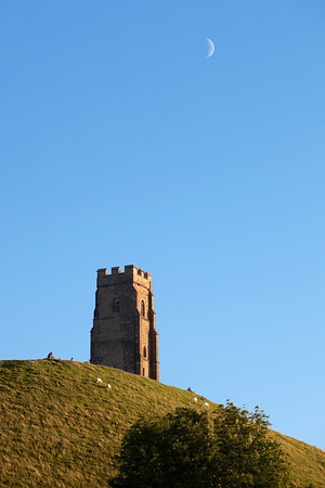 Crescent moon over Glastonbury Tor